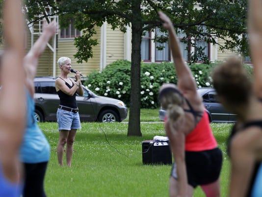 636543828484847193-APC-Yoga-in-the-park-071217Jump2-rbp065.jpg