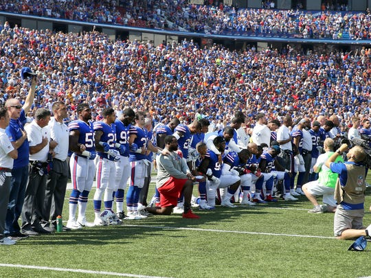 Some Bills players take a knee during the national anthem in response to President Trumps remarks that the NFL should fire any players who kneel during the anthem.