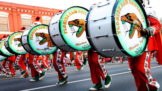The Marching 100 performs as the Florida A&M Homecoming parade makes its way along  Monroe Street during a previous homecoming weekend.