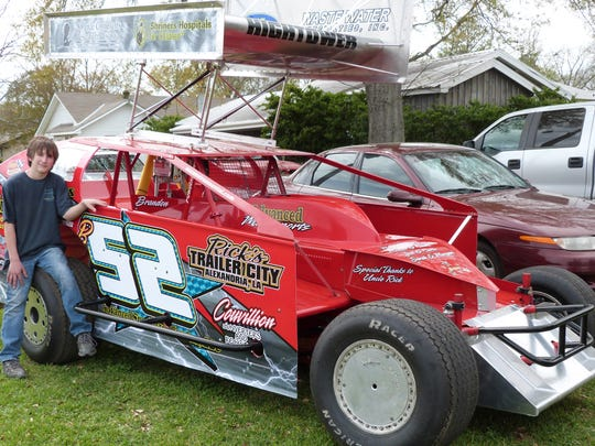 Brandon Hightower, 14 at the time, poses with an East Coast Modified racer before his first race in 2012. Now 18, the Deville native is achieving his childhood dream of racing in NASCAR.