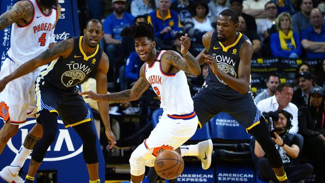 Feb 12, 2018: Phoenix Suns guard Elfrid Payton (2) loses the ball between Golden State Warriors forward Andre Iguodala (9) and forward Kevin Durant (35) during the second quarter at Oracle Arena.
