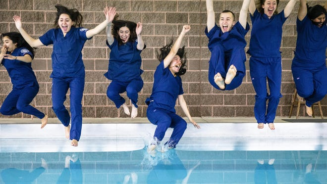 "Guadalupe Nino, center, of Chicago, Ill., hits the pool water first with the second graduating class of the University of Illinois at Chicago\'s College of Nursing Springfield Campus as the students perform the program\'s first \xd2Pool Jump\xd3 to celebrate graduating with their bachelor\'s degree in nursing, or BSN, at FitClub South, Friday, May 3, 2019, in Springfield, Ill. The tradition of the ""Pool Jump"" goes back to over 30 years ago to the UIC main campus and is believed to be a twist on the Nightingale Pledge, a professional oath for nurses named in honor of Florence Nightingale."