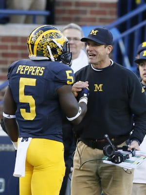 Michigan's Jabrill Peppers gets a smile and handshake from head coach Jim Harbaugh after Peppers' touchdown against Rutgers in the second quarter on Saturday, Nov 7, 2015, in Ann Arbor.