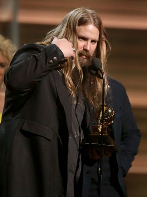 """Chris Stapleton accepts the award for Best Country Album for """"Traveller"""" at the 58th annual Grammy Awards on Monday."""