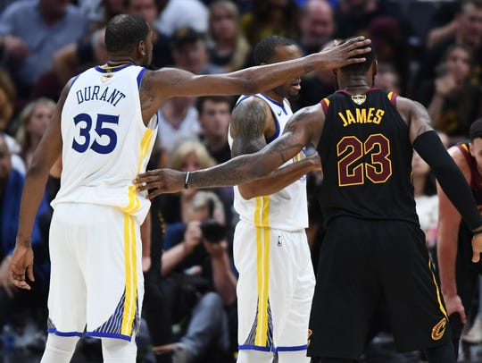 June 8: LeBron James congratulates Kevin Durant before
