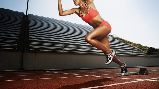 Women running on athletic track