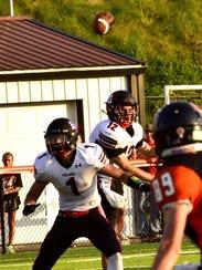 East Central Quarterback Alex Maxwell (12) delivers