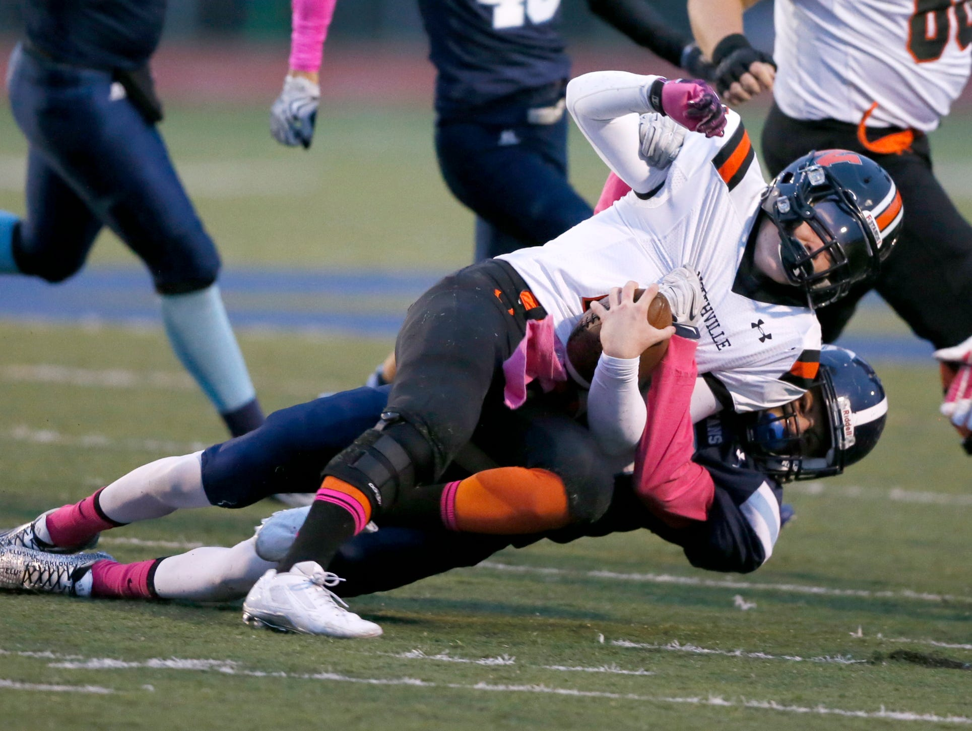 Northville's Justin Zimbo is tackled by Livonia Stevenson's Jack Balint at the end of a run Oct. 2, 2015, in Livonia.
