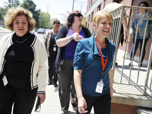 (From left) Family First Health CFO Lila Beedle, referral specialist Nelly Quiles, communications coordinator Jess Ensminger and development director Courtney Lewis take a walk around the block in York during their lunch break in honor of 'National Walk at Lunch Day' in April. (Daily Record/Sunday News -- Chris Dunn)