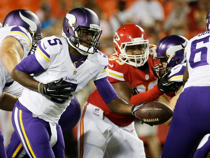 Minnesota Vikings quarterback Teddy Bridgewater (5) hands off the ball during the second half of an NFL preseason football game against the Kansas City Chiefs in Kansas City, Mo., Saturday, Aug. 23, 2014. (AP Photo/Charlie Riedel)