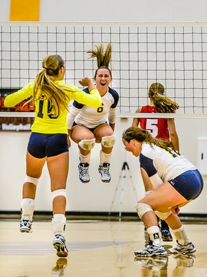 Brooke Binkley, center, and DeWitt head into the postseason ranked No. 4 in Class A.