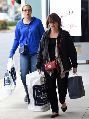 "Early shoppers found bargains and plenty of specials at Tanger Outlet Centers in Rehoboth Beach on ""Black Friday"", November 25th. By 8am parking lots were starting to fill up as the Christmas Shopping Season got started."