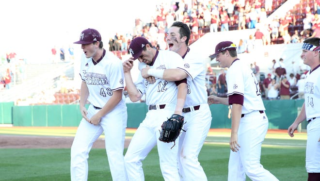 Mississippi State pitcher Reid Humphreys (center) was selected by the Colorado Rockies on Friday.