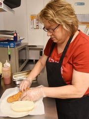 Elaine Funk readies a fishtail sandwich at Funk's Ice Cream and Sandwiches in Zanesville.