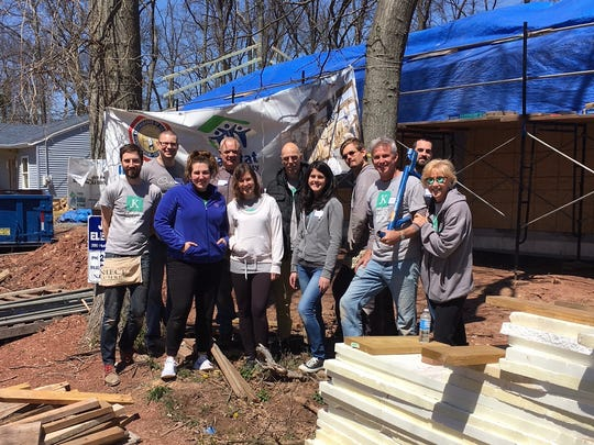 A team from JK Design spent April 20 helping to build a house in Franklin Township with Raritan Valley Habitat for Humanity (RVHFH).