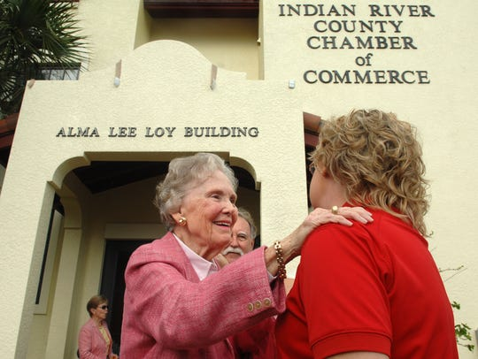 Alma Lee Loy (left) talks with Vero Beach High School