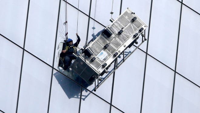 Window washers are rescued from a damaged scaffold on Nov. 12 at One World Trade Center in New York.