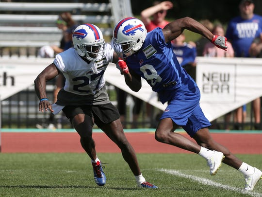 Bills rookie receiver Robert Foster (8) works against cornerback Tre'Davious  White during practice. Foster's exceptional speed may help him earn a roster spot.
