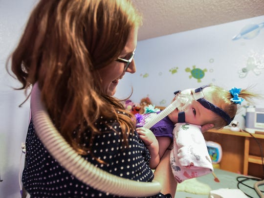 Stephanie Kliewer holds her 16-month-old daughter Elke as she wakes up from a nap July 14, in Fort Collins.