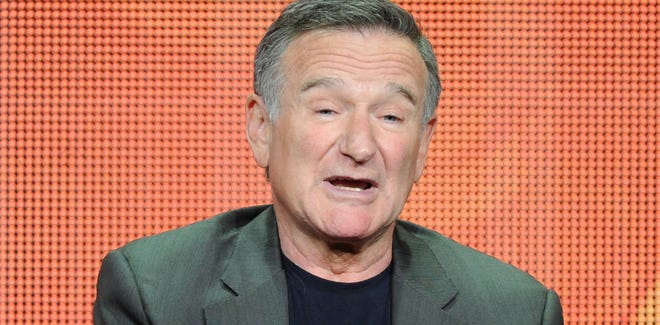 """Actor Robin Williams participates in the """"The Crazy Ones"""" panel at the 2013 CBS Summer TCA Press Tour at the Beverly Hilton Hotel in Beverly Hills, Calif."""