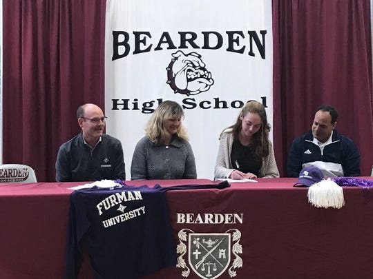 Julia Adams signs her letter of intent to play tennis at Furman during a ceremony at Bearden on Friday, Nov. 10, 2017.