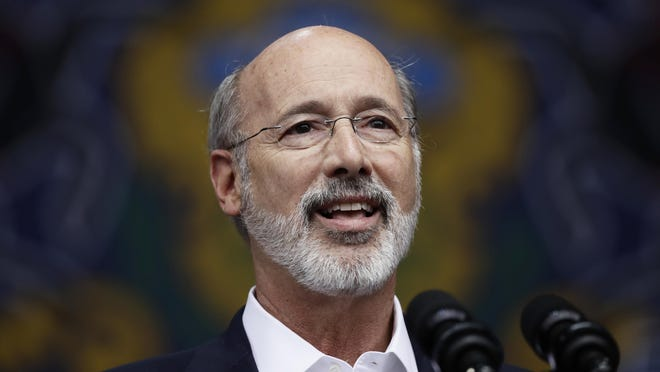 FILE - In this Sept. 21, 2018, file photo Gov. Tom Wolf speaks at a campaign rally for Pennsylvania candidates in Philadelphia. In recent campaign appearances Wolf has inaccurately claimed a Pennsylvania Senate report released this summer recommended that the death penalty moratorium Wolf imposed shortly after taking office should remain in place. (AP Photo/Matt Rourke, File)