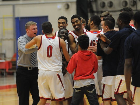 Shippensburg's men's basketball team celebrates after defeating Bloomsburg, 80-78, in the first round of the PSAC Tournament on Saturday.