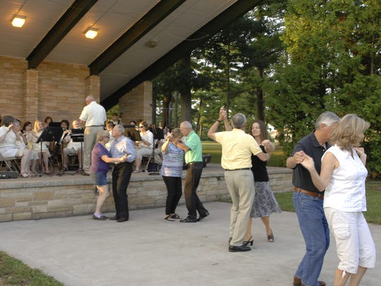 Dancers enjoying a Wisconsin Rapids City Band Concert at Robinson Park in Wisconsin Rapids
