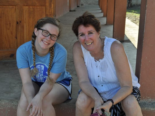 Jordan Wales, left, and her grandmother Therese Casler, traveled to Haiti where Wales created a mobile library as part of her senior project at Merrol Hyde Magnet School.