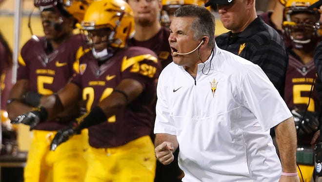 ASU  coach Todd Graham is upset with his team after a penalty was called against them during the first quarter of an game against Weber State at Sun Devil Stadium on August 28, 2014.