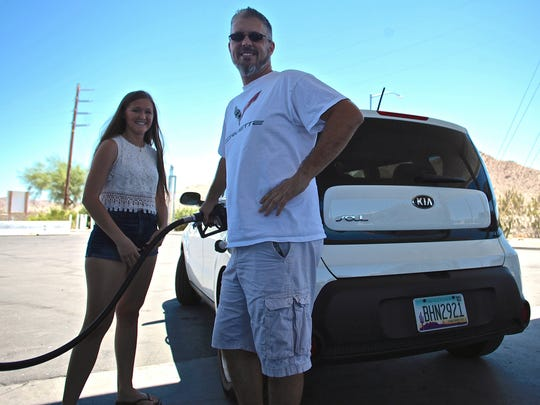 Matt Brunkow, 46, and Olivia Brunkow, 19, of Phoenix Ariz. stop at the Chevron gas station Friday in Chiriaco Summit, after traveling the newly opened I-10 westbound lane five days after the collapse of the Tex Wash Bridge.