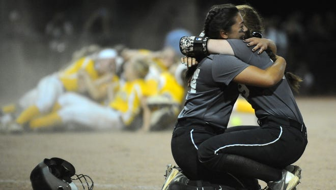 Egg Harbor Township's Kate Korte, left, hugs teammate Miranda Cincotti after the Eagles fell to Watchung Hills in the Group 4 state final at Kean University on  Friday night.