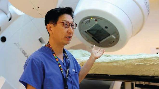 Guam Regional Medical City radiation oncologist Dr. Arthur Ko shows the hospital's advanced linear accelerator, which can be used to treat cancer patients.