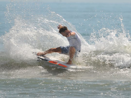 Big crowds and small waves showed up for the 32nd annual NKF Rich Salick Pro-Am Surf Festival at the Cocoa Beach Pier on Saturday. Evan Thompson of Jacksonville Beach had a good heat in the men's open pro.