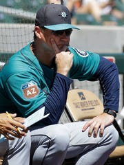 Seattle Mariners manager Scott Servais watches from field level in the first inning of a spring training baseball game against the Colorado Rockies in Scottsdale, Ariz., Saturday, April 2, 2016.