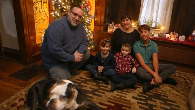 Dave and Hannah Crawford with their family. From left: Skylar, Tommy and Jordan with their dog Athena.