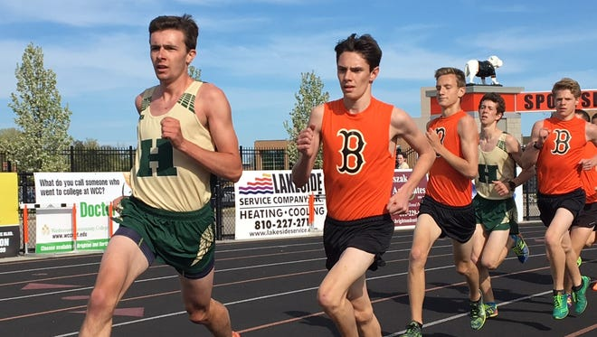 Howell's David Mitter (left) has the fastest 1,600-meter and 3,200-meter times in Livingston County this season.