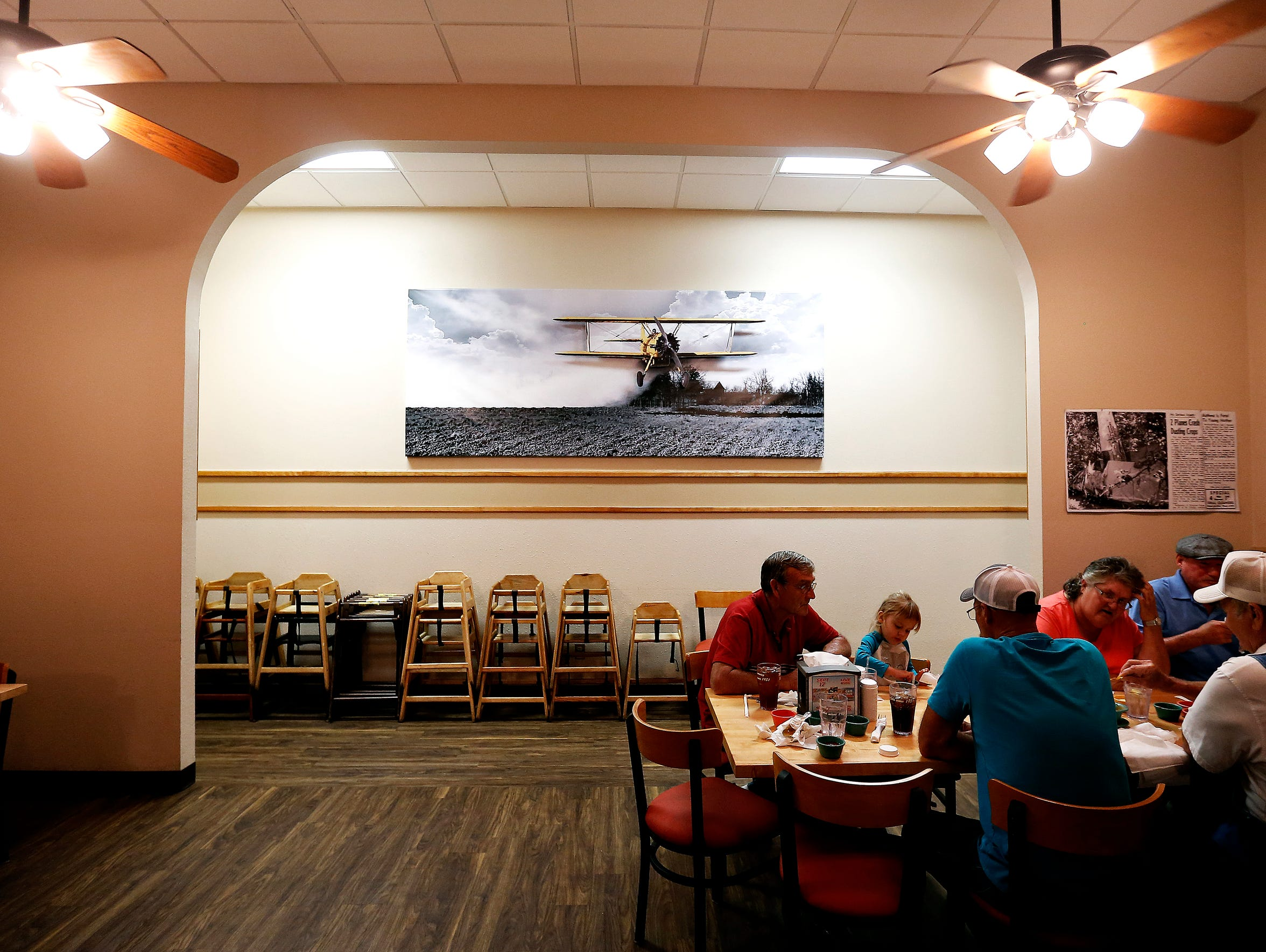 Patrons dine in front of a large photograph displaying