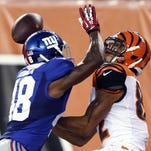 Giants cornerback Chandler Fenner, left, breaks up a pass to Cincinnati Bengals wide receiver Marvin Jones duirng the first half of a preseason football game on Friday.