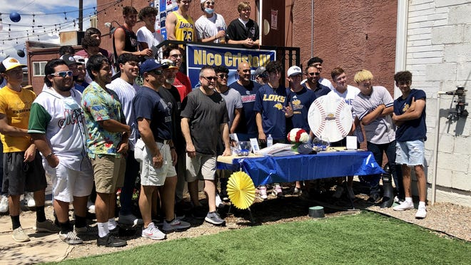 Nico Cristelli stands with former teammates and coaches for his college baseball signing Sunday at Walter's Brewery & Taproom
