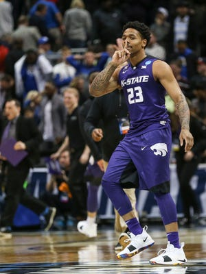 Kansas State's Amaad Wainright shushes the UK crowd in same vein that UK's Shai Gilgeous-Alexander did the week prior as the other Wildcats won 61-58 in Thursday night's Sweet Sixteen game in Atlanta, March 22, 2018.