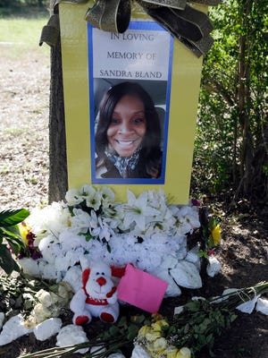 Flowers and other items adorn a memorial July 21, 2015, for Sandra Bland near Prairie View A&M University in Prairie View, Texas.