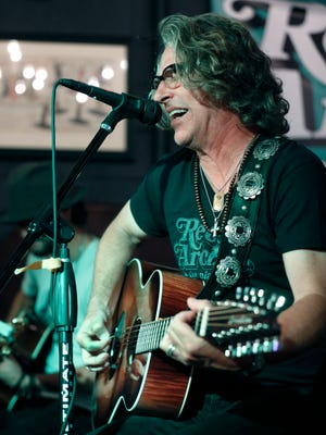Collective Soul members Ed Roland and Jesse Triplett perform at Record Archive for a small crowd. They played guitar and an out of tune piano in an intimate setting.