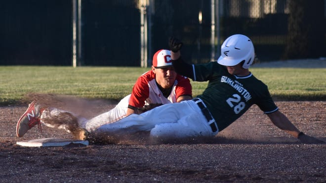 West Burlington's Riley Ruther is caught stealing second base as Cardinal shortstop Blaine Bryant makes the tag Monday in the third inning at West Burlington.