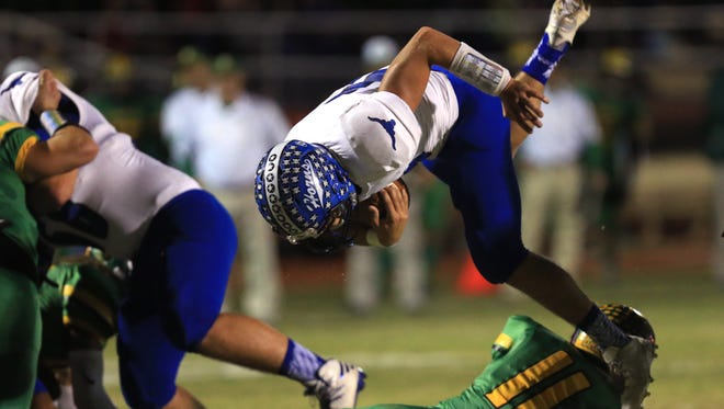 George West's Kyle Gee jumps over a Bishop player to gain a few yards in the first quarter quarter of the game at Memorial Stadium in Alice, Texas on Friday, Nov. 11, 2016. Despite being within a few yards of a touchdown, the team settled for a field goal.