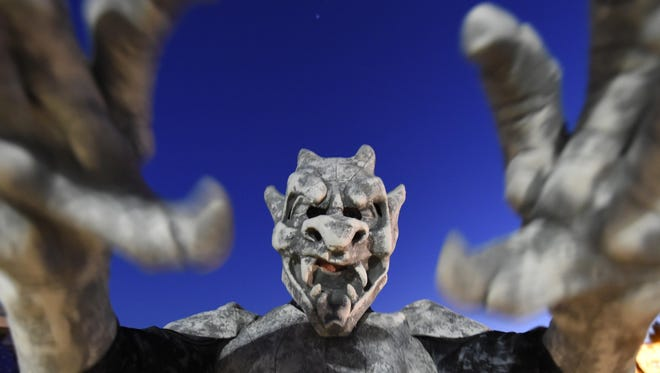 A gargoyle — actually, it's Montana Grosbeier of Algoma under all that costume — reaches out to greet visitors outside the 2016 Haunted Mansion at Quietwoods South Camping Resort in Brussels.