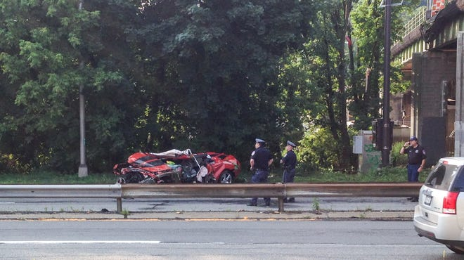 Police investigate a fatal crash Wednesday in which a  drove off the Ashford Avenue bridge onto the Saw Mill River Parkway.