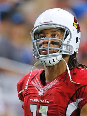 Arizona Cardinals wide receiver Larry Fitzgerald loos at the scoreboard during a game against the Detroit Lions on Nov. 16, 2014 in Glendale.