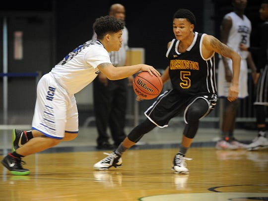 King's Christian's D'Angelo Tull drives against Washington's Josh Sproul on Tuesday, Dec. 27, 2016 at the 36th Annual Governor's Challenge.