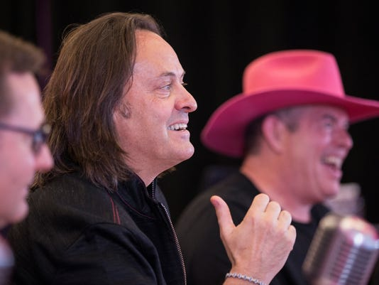 AP T-MOBILE REPORTS Q1 EARNINGS A CPACOM USA WA